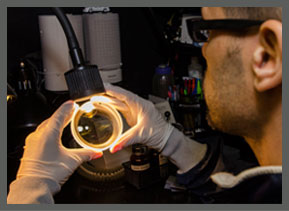 precision optic technician inspecting a custom optic