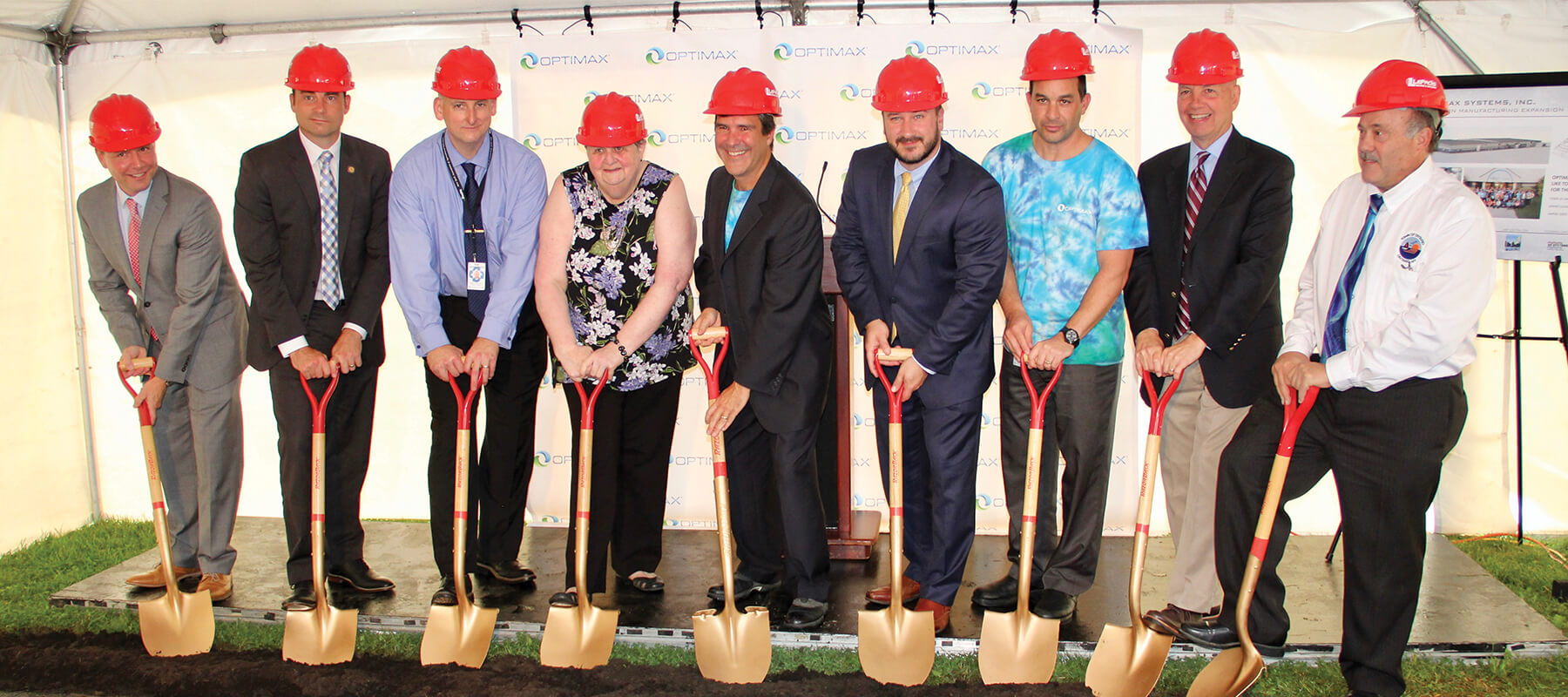 Optimax team during groundbreaking expansion